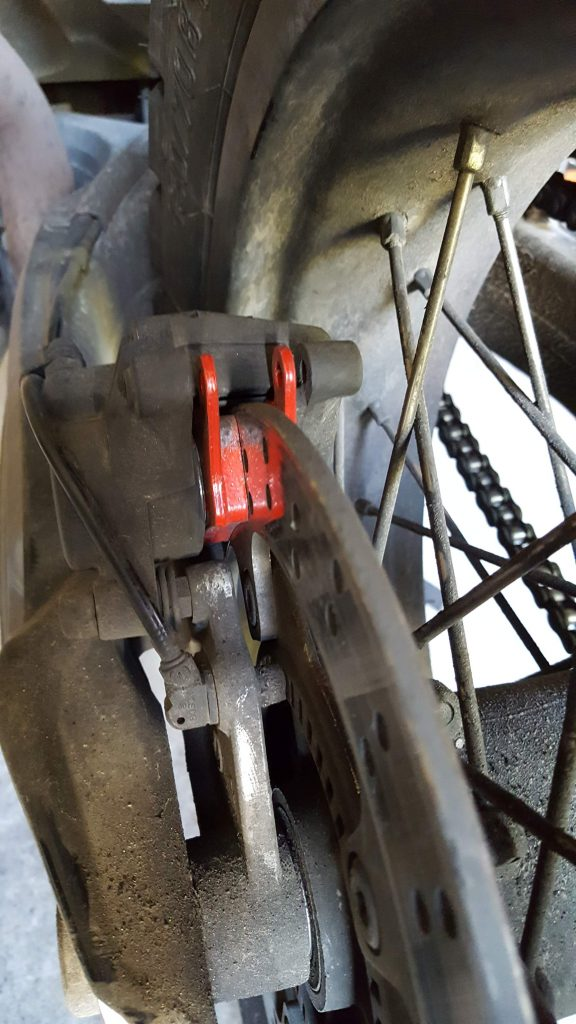 Bremssattel mit neuen Bremsbelägen